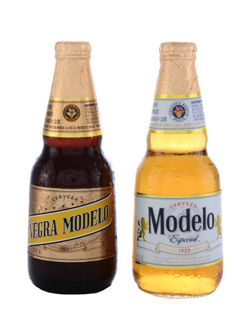 especial: IRVINE, CA - JUNE 14, 2015: A bottle of Modelo Especial and Negra Modelo. Brewed by Grupo Modelo a large brewery in Mexico owned by Belgian-Brazilian company Anheuser-Busch InBev.