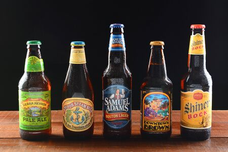 adams: IRVINE, CA - JUNE 18, 2015: A variety of popular domestic beer brands. Five brands including, Samuel Adams, Anchor Steam, Sierra Nevada, Downtown Brown and Shiner Bock Editorial