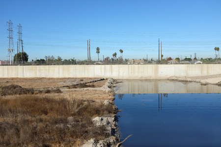 orange county: Santa Ana River in Orange County, California. The line where the concrete lined urban river meets the natural river bottom in Costa Mesa.