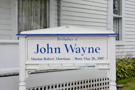 john wayne: WINTERSET, IOWA - AUGUST 20, 2015: Sign at the John Wayne Birthplace. On the grounds of the museum that opened to the public in May of 2015.