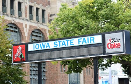annual event: DES MOINES, IOWA - AUGUST 19, 2015: Iowa State Fair sign. The annual event covering over 450 acres is one of the largest state fairs in the country.
