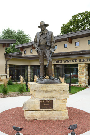 john wayne: WINTERSET, IOWA - AUGUST 20, 2015: Statue of John Wayne at the John Wayne Birthplace Museum. The museum opened to the public in May of 2015.