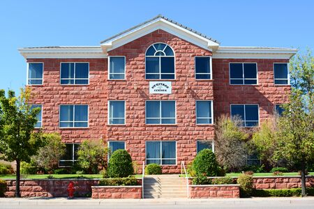 three story: ST. GEORGE, UTAH - AUGUST 15, 2015: Heritage Corner Office Building. The three story, centrally located office building features the areas trademark red sandstone exterior.