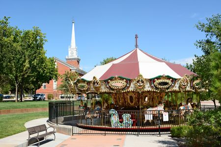 tabernacle: ST. GEORGE, UTAH - AUGUST 15, 2015: Town Square Carousel. The old fashioned ride, with the St George Tabernacle in the background, in in the towns historic district. Editorial