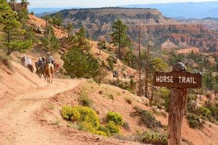 trails: BRYCE CANYON, UTAH - AUGUST 17, 2015: Riders on the Horse trail portion of the Queens Garden Trail in the Amphitheater area of Bryce Canyon National Park, Utah.