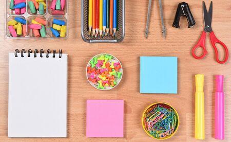 arranged: School supplies arranged on a students desk. Closeup overhead view.
