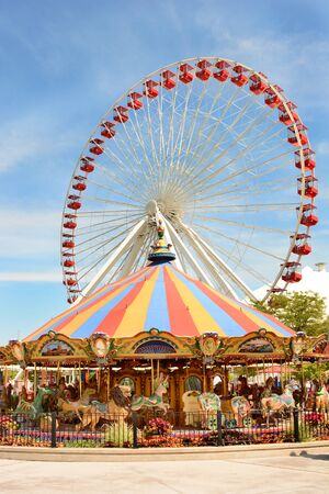 colourful sky: CHICAGO, ILLINOIS - AUGUST 22, 2015: Navy Pier rides. The Ferris Wheel and Carousel are popular attractions on Chicagos Navy Pier on Lake Michigan. Editorial