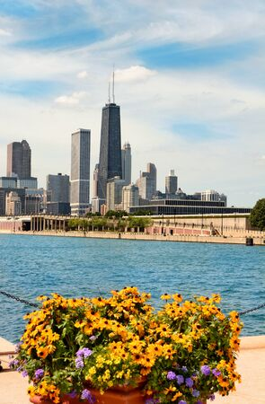 building structures: CHICAGO, ILLINOIS - AUGUST 22, 2015: Chicago skyline seen from Navy Pier. The John Hancock Center the 6th tallest building in the USA rises above surrounding structures. Editorial