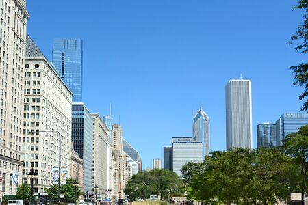 millennium: CHICAGO, ILLINOIS - AUGUST 22, 2015: Chicago skyline. Chicago skyline seen from Grant Park along Columbus Avenue.