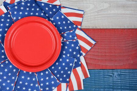 high angle shot: High angle shot of American Flag napkins on a red, white and blue picnic table. Horizontal format with copy space. Suitable for American Holidays: 4th of July and Memorial Day, and Veterans Day.