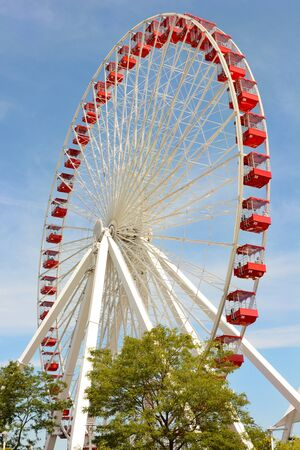 scheduled: CHICAGO, ILLINOIS - AUGUST 22, 2015: Navy Pier Ferris Wheel. The current Ferris Wheel is slated for replacement with a modern and larger wheel, scheduled to open in 2016.