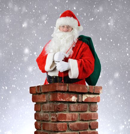 st nick: Santa Claus inside a brick chimney with his bag of toys flung over his shoulder. Vertical format with a snowy background.
