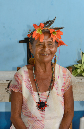 amazonia: SANTA ANA VILLAGE, PERU - OCTOBER 16, 2015: Shaman in Santa Ana Village, near Iquitos, Peru. The medicine woman is an intergral part of Amazonia culture.