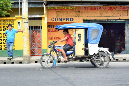 peru amazon: IQUITOS, PERU - OCTOBER 17, 2015: MotoKar on Iquitos street.  MotoKars are the most common form of street transportation in the Peruvian Amazon. Editorial