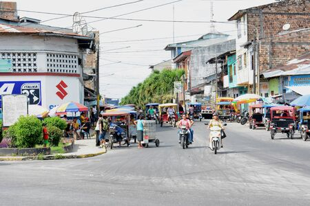 autorick: IQUITOS, PERU - OCTOBER 17, 2015: MotoKars and motorcycles. Motorcycles and MotoKars are the most common forms of transportation in the Amazon.