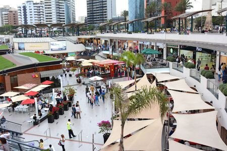 miraflores: LIMA, PERU - OCTOBER 18, 2015:  Larcomar Mall in Miraflores, Peru. Shoppers in the outdoor mall that sits between the ocean and Alfredo Salazar Park. Editorial