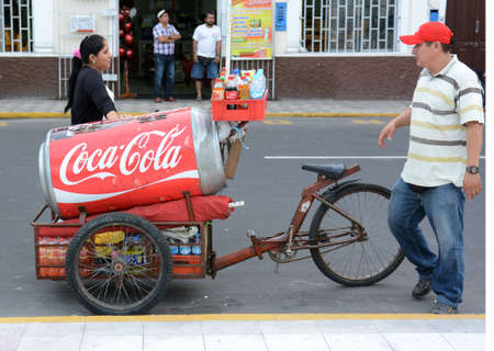 street vendor: IQUITOS, PERU - OCTOBER 17, 2015: Street Vendor. Street Vendors with bicycle powered carts are a common sight in the Amazon City.