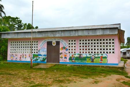 peru: SANTA ANA VILLAGE, PERU - OCTOBER 16, 2015: Elementary school building. Many villages in the Amazon region of Peru have their own schools.