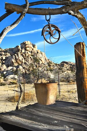 boarded: JOSHUA TREE, CALIFORNIA - JANUARY 1, 2016: Boarded up well at Keys Ranch. Rustic abandoned well in Joshua Tree National Park.