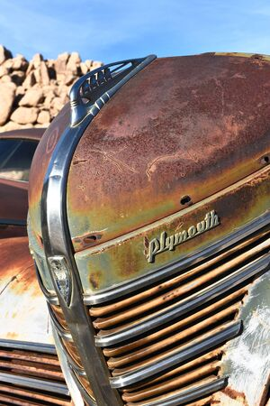 joshua tree national park: JOSHUA TREE, CALIFORNIA - JANUARY 1, 2016: Plymouth Grill. The front end of a rusted old Plymouth at Keys Ranch in Joshua Tree National Park.