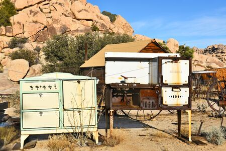 collected: JOSHUA TREE, CALIFORNIA - JANUARY 1, 2016: Old Stoves at Keys Ranch. The property is littered with items collected by homesteader Bill Keys. Editorial