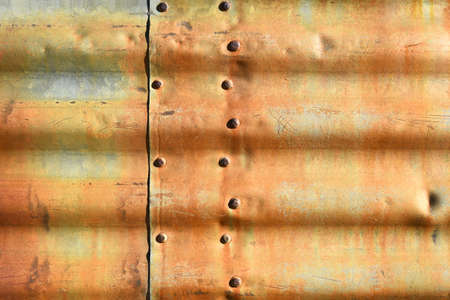 rivets: Rusty corrugated metal with rivets. Stock Photo