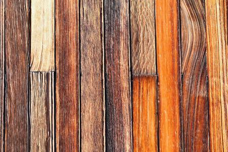 slats: Closeup of weathered wood barn siding.