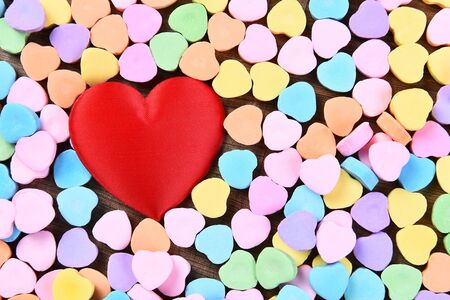 greem: A red heart surrounded by Valentines Day candy hearts.