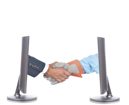 accord: Management and Labor handshake. Two hands one businessman in suit and gloved workers hand coming out of two computer screens. Business Accord Concept.
