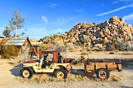 joshua: JOSHUA TREE, CALIFORNIA - JANUARY 1, 2016: Jeep and Trailer. A rusted old Jeep at Keys Ranch in Joshua Tree National Park.