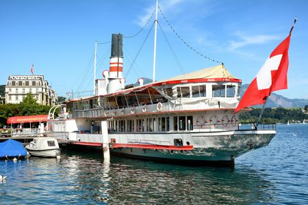 permanently: LUCERNE, SWITZERLAND - JULY 3, 2014: The Wilhelm Tell Restaurant. On Lake Lucerne the century old paddle steamer is permanently anchored and a first class restaurant.