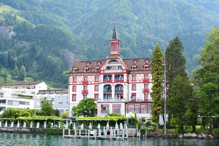 VITZNAU, SWITZERLAND - JULY 4, 2014: Hotel Vitznauerhof. The four star accommodation, built in 1091, is seen from a boat on Lake Lucerne.