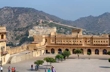 ramparts: JAIPUR, INDIA - NOVEMBER 3, 2015: Amber Fort also know as Amer Fort. High on a hill it overlooks Maota Lake. Editorial