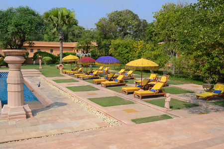 acres: JAIPUR, INDIA - NOVEMBER 2, 2015: Pool area at the Oberoi Rajvilas. The resort is set on 32 acres of beautifully landscaped gardens.