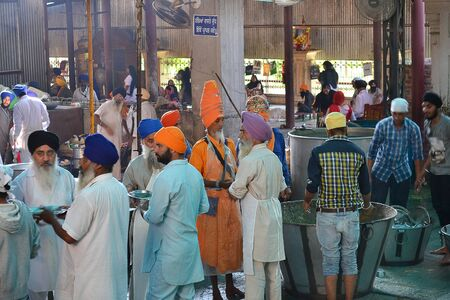 harmandir sahib: AMRITSAR, INDIA - 30 OCTOBER 2015: Community kitchen at the Golden Temple, Sri Harmandir Sahib (The Abode of God).