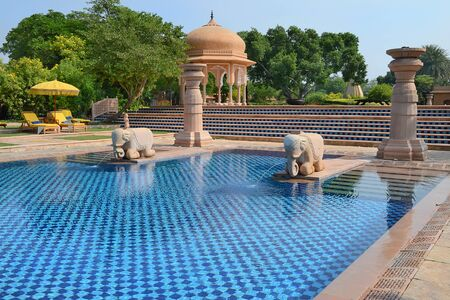 JAIPUR, INDIA - NOVEMBER 2, 2015: Pool area at the Oberoi Rajvilas. The resort is set on 32 acres of beautifully landscaped gardens.