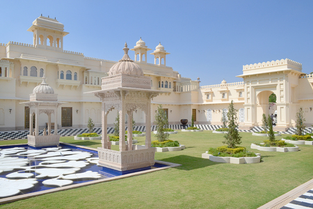 UDAIPUR, INDIA - NOVEMBER 4, 2015: The Oberoi Udaivilas. The luxury hotel is situated on Lake Pichoola in Udaipur, Rajasthan, India.