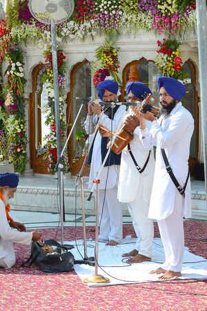 harmandir sahib: AMRITSAR, INDIA - 30 OCTOBER 2015: Sikh Musicians perform at the Golden Temple. Sri Harmandir Sahib (The Abode of God) is the holiest Sikh gurdwara.