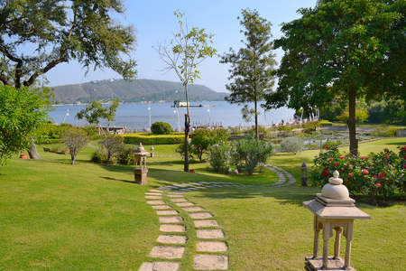 UDAIPUR, INDIA - NOVEMBER 4, 2015: The Oberoi Udaivilas grounds. The luxury hotel is situated on Lake Pichoola in Udaipur, Rajasthan, India.