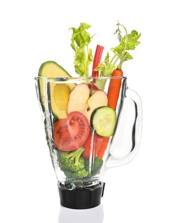 juicing: Vegetables in a blender ready for juicing. Healthy eating concept. Stock Photo