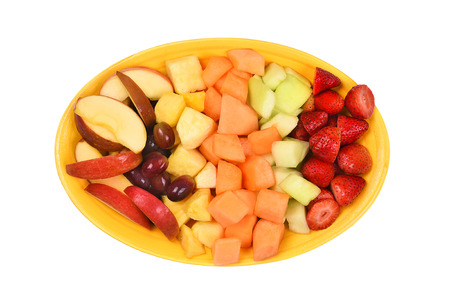 plate: A platter of fresh cut fruit. Isolated on white fruits include, Strawberry, Pineapple, Apple, Cantaloupe, Honeydew Melon and Grapes.