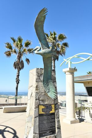 huntington beach: HUNTINGTON BEACH, CA - MARCH 25, 2015: Pelican Statue Lifeguard Memorial. The monument honors former Chief Lifeguard Vincent G. Moorehouse. Editorial