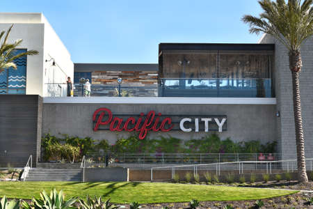 shop sign: HUNTINGTON BEACH, CA - MARCH 25, 2015: Pacific City. Located on the Pacific Coast Highway, the upscale development features shops and restaurants.