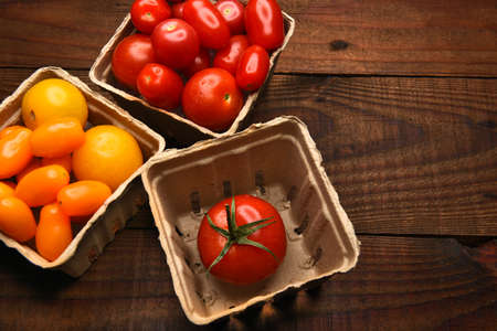 medley: Top view of produce baskets filled with a variety of medley tomatoes. Horizontal format with copy space.