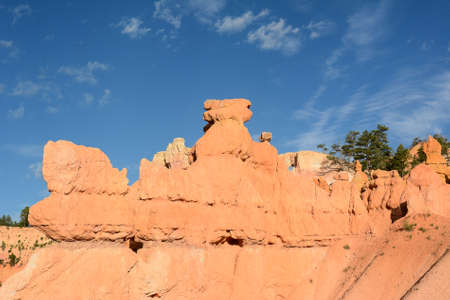 horizontal format: Bryce Canyon scenic in horizontal format with blue cloudy sky.