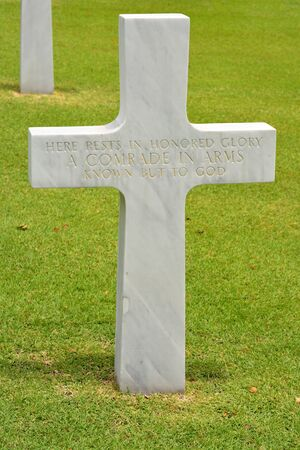 wwii: MANILA, PHILIPPINES - APRIL 1, 2016: Cross at Manila American Cemetery. With 17,206 graves it is the largest WWII cemetery for US personnel. Editorial