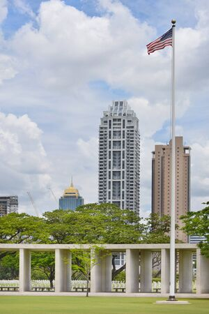 wwii: MANILA, PHILIPPINES - APRIL 1, 2016: Manila American Cemetery and Memorial and city skyline. With 17,206 graves it is the largest WWII cemetery for US personnel. Editorial