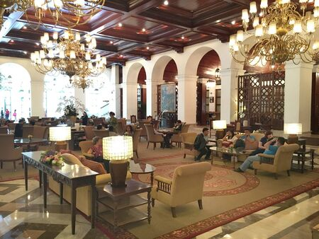luxuries: MANILA, PHILIPPINES - APRIL 2, 2016:  Manila Hotel Lobby. Guests gather in the lobby of the iconic hotel. Editorial