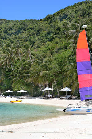 nido: EL NIDO, PANGULASIAN, PHILIPPINES - APRIL 5, 2016:  Boats and beach at the Pangulasian Island Resort. Editorial