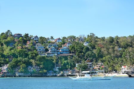 BORACAY, PHILIPPINES - APRIL 7, 2016: Shangri La Boracay Resort and Spa from the water. The luxury resort is adjacent ot an eco-reserve.